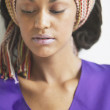 Close up of woman wearing headscarf - Stock Photo