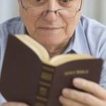 Senior man reading the Bible — Stock Photo #23233704