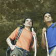 Two young men hiking in the forest - Stock Photo