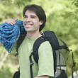 Man holding a bundle of climbing rope — Stock Photo #23233796