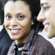 Stock Photo: Portrait of businesswomwith earpiece
