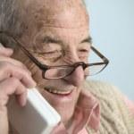 Elderly man talking on cell phone — Stock Photo #23233820