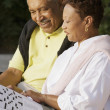 Senior couple working on crossword puzzle together — Stock Photo