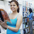 Stock Photo: Women reading in library