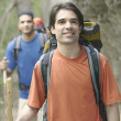 Two young men hiking in the forest — Stockfoto