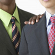 African American businessman's hand on businessman's shoulder — 图库照片