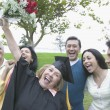 Graduate mother cheering her success - Stock Photo