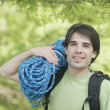 Man holding a bundle of climbing rope — Stock Photo