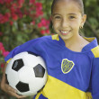 Portrait of a young female soccer player — Stock Photo