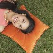 Woman outside lying on pillow — Stock Photo