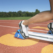 Side view of track athlete in starting blocks - 图库照片
