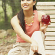 Young woman holding wine glass — Stock Photo