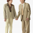 Senior couple holding hands - Stock Photo