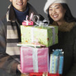 Young couple with holiday gifts - Stock Photo