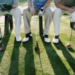 Stock Photo: Golfers sitting on bench