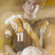 Teenage boy holding soccer ball - Stock Photo