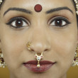 Stock Photo: Indiwomwearing traditional facial jewellery