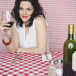 Stock Photo: Portrait of woman in restaurant drinking wine