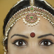 Indian woman wearing a bindi on her forehead - Stock Photo