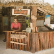 Young man working at a beach reception desk — Stok fotoğraf