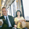 Businessman and woman commuting on subway — Stock Photo