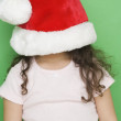 Royalty-Free Stock Photo: Girl with Santa hat pulled down over face