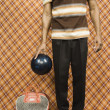Young man holding a bowling ball — Stock Photo
