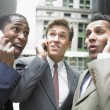 Businessmen talking on cell phone — Stock Photo