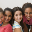 Portrait of four girls smiling - Stockfoto