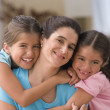 Portrait of mother with two daughters — Stock Photo #23238060