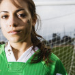 Portrait of girl in front of goal net - Stok fotoğraf