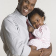 Businessman holding his baby daughter — Stock Photo