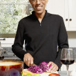 Stock Photo: Portrait of mcutting vegetables in kitchen