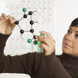 Stock Photo: Portrait of woman holding science model