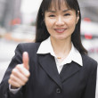 Royalty-Free Stock Photo: Businesswoman giving thumbs up