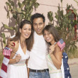 Family draped in an American flag — Stock Photo