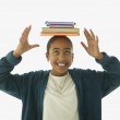 Girl balancing books on head — Stock Photo