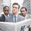 Businessmen reading newspaper — Stock Photo