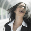 Businesswoman tossing her hair — Stock Photo