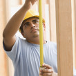 Construction worker with measuring tape — Stock Photo