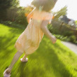 Girl running in blurred motion — Stock Photo #23238730