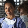 Royalty-Free Stock Photo: Portrait of two female doctors in scrubs