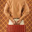 Young man holding a briefcase — Stock Photo