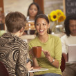 Women talking in coffee house — Foto Stock