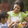 Woman and girl with basket of produce — Stockfoto