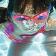 Girl underwater with goggles — Stock Photo