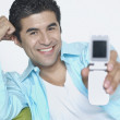 Young man showing off his cell phone — Stok fotoğraf