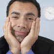 Sleepy businessman at his desk - Stockfoto