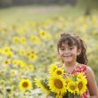 Young girl holding sunflowers - Stock Photo