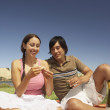 Couple having a picnic — Stock Photo